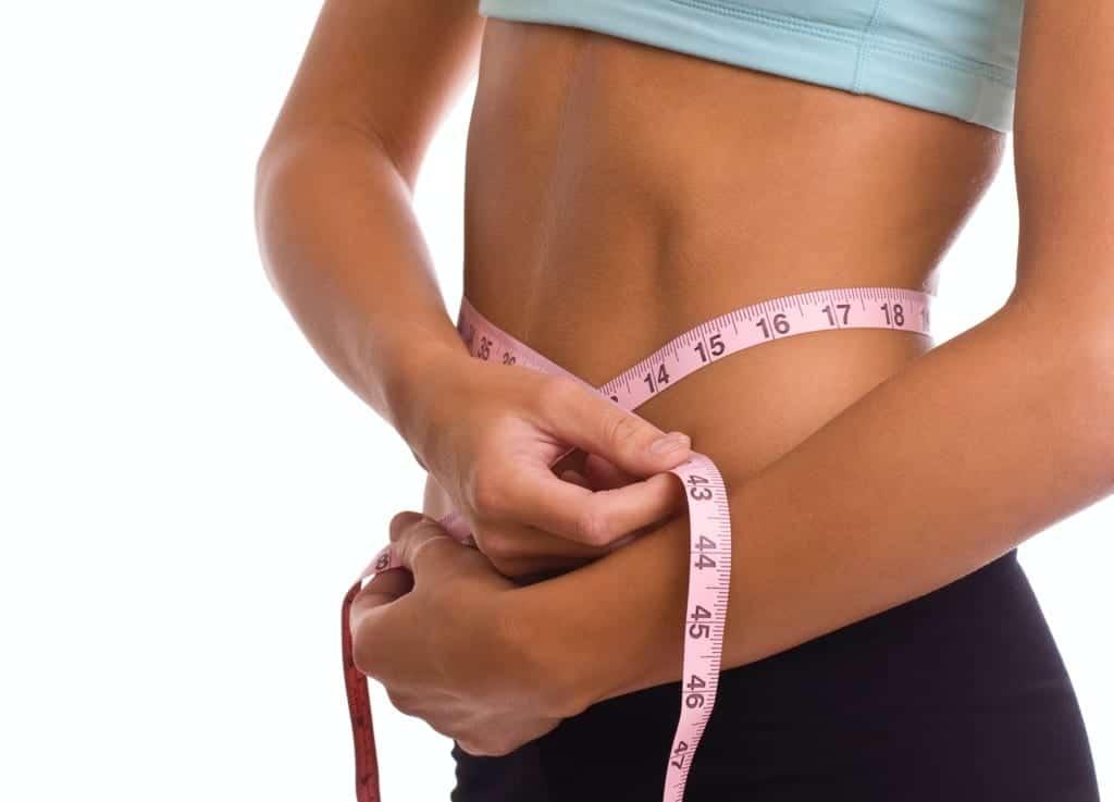 woman measuring waist stimulating weight loss